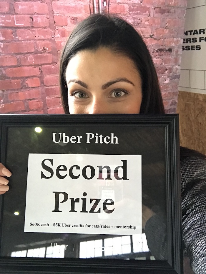 Female Founder holds second place prize from girlboss business plan competition wins nonequity funding
